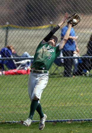 DAVID LE/Staff photo. Pentucket left fielder Ryan DePaolo makes a lunging grab to retire a Manchester-Essex batter. 4/23/16.