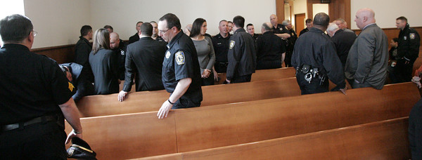 KEN YUSZKUS/Staff photo.    Many police officers attended the arraignment of Jeremiah Wooden in Salem District Court for shooting at a Salem police officer who tried to arrest him on warrants in Salem.     04/19/16