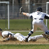 KEN YUSZKUS/Staff photo.   Danvers Andrew Olszak gets on 2nd as Peabody's Jake Gustin loses the ball at the Danvers at Peabody baseball game.       04/18/16
