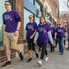 PARKER FISH/ photo. A group of participants walks along the sidewalk on Derby Street. 4/24/16