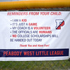 PAUL BILODEAU/Staff photo. A reminder to parents on the fence during the annual Peabody Western Little League jamboree held at Cy Tenney Field in West Peabody.