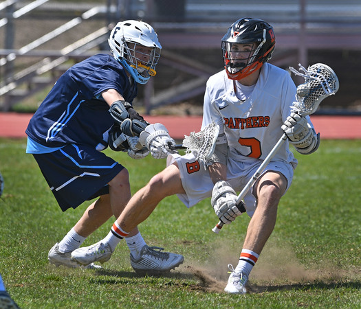 Beverly middie Kyle Chouinard cuts away from a Franklin defender during the game at Masconomet HS today.<br /> <br /> Photo by JoeBrownPhotos.com