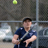 RYAN HUTTON/ Staff photo<br /> Peabody's Tori Thompson returns the ball during her 1st Singles match against Gloucester's Lexi Zubrocki during Monday's tennis match at Peabody High.