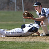KEN YUSZKUS/Staff photo.   Danvers Andrew Olszak gets back safely to 1st as Peabody's Jake Doherty gets the throw at the Danvers at Peabody baseball game.       04/18/16