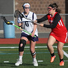 KEN YUSZKUS/Staff photo.   Peabody's Amanda Bradley, left, is being badgered by Salem's Thalia Urena at the Salem at Peabody girls lacrosse game.       04/29/16