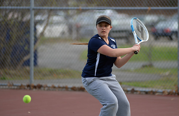 RYAN HUTTON/ Staff photo<br /> Peabody's Tori Thompson readies her backhand as the ball approaches during her 1st Singles match against Gloucester's Lexi Zubrocki during Monday's tennis match at Peabody High.