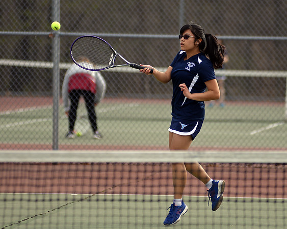 RYAN HUTTON/ Staff photo<br /> Peabody's Isabela Valencia returns the ball during her 2nd Singles match against Gloucester's Tea Ryder during Monday's tennis match at Peabody High.