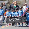 PARKER FISH/ photo. Members of the Jaguars Little League team march in the parade during the league's opening ceremonies. 4/24/16
