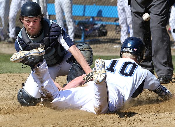 KEN YUSZKUS/Staff photo.    Peabody's catcher Aaron Dollin loses the throw as Danvers' Matt Andreas slides home at the Danvers at Peabody baseball game.       04/18/16