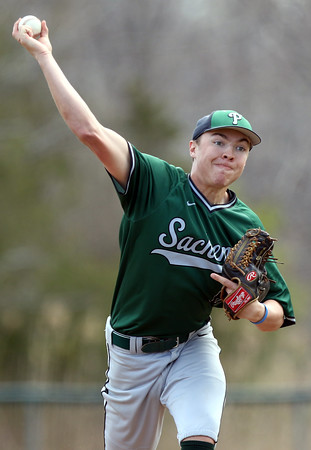 DAVID LE/Staff photo. Pentucket relief pitcher _______ fires a pitch against Manchester-Essex on Saturday afternoon. 4/23/16.