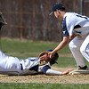 KEN YUSZKUS/Staff photo.   Danvers' Tommy Mento gets back safely to 1st as Peabody's Jake Doherty gets the throw at the Danvers at Peabody baseball game.       04/18/16