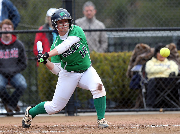 DAVID LE/Staff photo. Endicott College senior Emily Hoffman keeps her eyes on the ball and bloops a RBI single into right against Roger Williams on Saturday afternoon. 4/23/16.