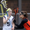 DAVID LE/Staff photo. Peabody midfielder Lauren Wolff (5) looks to make a play while being defended face-to-face by Beverly's Darcy McAuliffe, right. 4/12/16.