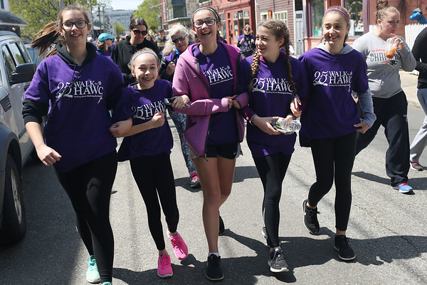 HADLEY GREEN/ Staff photo<br /> Hannah Justo, Emma Bedard, Caitlynn Burk, Angela Cutone, and Amila Babic, all students at Collins Middle School, march down Derby Street at the 25th annual Walk for HAWC in Salem on Sunday, April 30th, 2017. The 5K walk raises money for HAWC, an organization that helps people affected by domestic abuse.