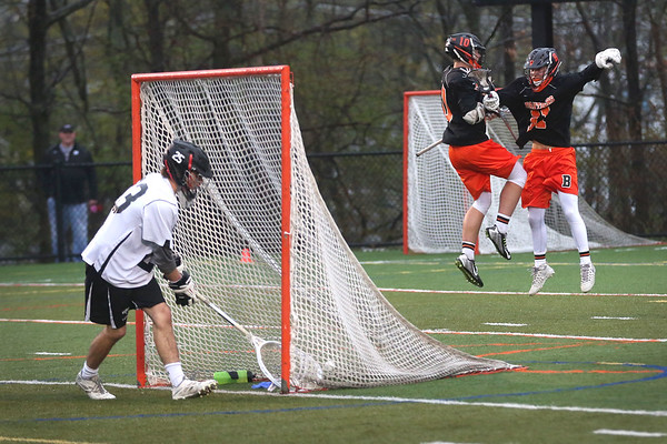 HADLEY GREEN/ Staff photo<br /> Beverly's Dakota Lillelund (11) celebrates with teammate Chris Cole (10) after scoring while Marblehead's goalie Matt Mills (23) retrieves the ball from the net during the Marblehead v. Beverly boys varsity lacrosse game held at Marblehead High School on Tuesday, April 25th, 2017.