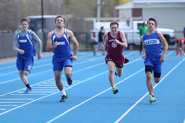 HADLEY GREEN/ Staff photo<br /> From left to right, Danvers' Will Flynn, Justin Curtis, Gloucester's Liam Falk and Danvers' Anthony Spignese near the finish line during the Danvers v. Gloucester track meet at Danvers High School on Tuesday, April 18th, 2017.