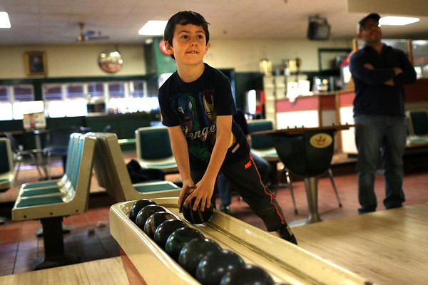 HADLEY GREEN/ Staff photo<br /> Brandon Rodkey of Beverly picks up a bowling ball while bowling with his dad and grandfather at the Bowl-O-Mat in Beverly on Friday, April 21st, 2017.
