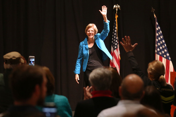 HADLEY GREEN/ Staff photo<br /> Senator Elizabeth Warren waves to the crowd as she takes the stage at a public town hall event at Salem High School on Thursday, April 13th, 2017.