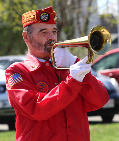 HADLEY GREEN/ Staff photo<br /> Steven Coddens, a Salem resident and Marine Corps veteran, plays taps during the annual wreath-laying ceremony at the Lexington Monument in Peabody on Patriots Day.