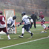 HADLEY GREEN/ Staff photo<br /> Gloucester's Kyle Aquipel (4) scores on Swampscott's goalie Perlin (25) at the Swampscott v. Gloucester boys lacrosse game at the Bertram Athletic Field in Salem on Friday, April 21st, 2017.