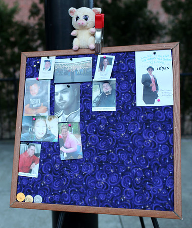HADLEY GREEN/ Staff photo<br /> People pinned photographs of loved ones they have lost to a memory board at the second annual Lost Lives Matter vigil for people who have died from opioid overdoses held at the Leather City Common in Peabody on Saturday, April 8th, 2017.