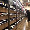 HADLEY GREEN/ Staff photo<br /> Susan Ring Brown of Beverly looks at wine in an aisle of the new Total Wine and More at the Liberty Tree Mall in Danvers during the store's preview party on April 26th, 2017.