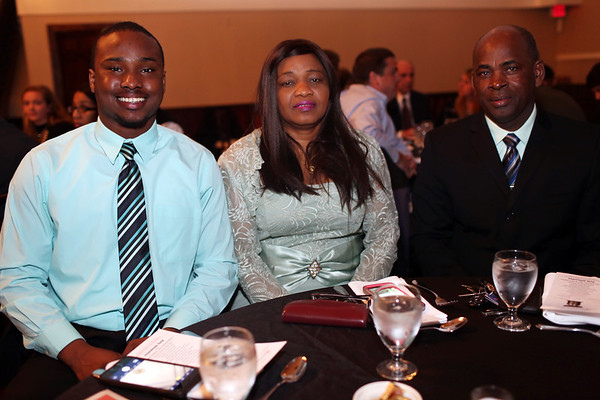 HADLEY GREEN/ Staff photo<br /> 2017 Salem News Student Athlete Hugh Calice sits with his parents Magalie, center, and Huri, right, at the Salem News Student Athlete Award dinner on Thursday, April 6th, 2017.