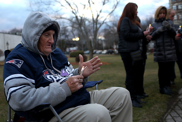 HADLEY GREEN/ Staff photo<br /> Bob Fabri lights a candle at the second annual at the Lost Lives Matter vigil for people who have died from opioid overdoses held at the Leather City Common in Peabody on Saturday, April 8th, 2017. Fabri lost his grandson, Daniel Amor, to an opioid overdose in 2015.