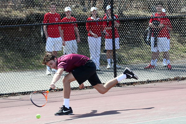 HADLEY GREEN/ Staff photo<br /> Gloucester's Dan MacDowell dives to return the ball while playing doubles at the Marblehead v. Gloucester boys tennis match at Marblehead High School on Monday,  April 17th, 2017.