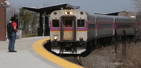People board a Boston bound train