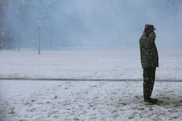 HADLEY GREEN/ Staff photo<br /> Surrounded by snow and smoke from the cannons, a National Guard member stands on the Salem Common during the commemoration ceremony of the Salem First Muster on April 1st, 2017.