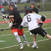 HADLEY GREEN/ Staff photo<br /> Beverly's Dakota Lillelund (11) runs up the field while Marblehead's Paul Heffernan (6) tries to stop him during the Marblehead v. Beverly boys varsity lacrosse game held at Marblehead High School on Tuesday, April 25th, 2017.