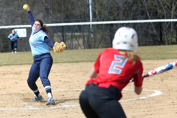 HADLEY GREEN/ Staff photo<br /> Gordon pitcher Caitlin Catalanotto (33) winds up before pitching to Eastern Nazarene's Rachel Caswell (2) at the Gordon College v. Eastern Nazarene College girls varsity softball game at Gordon College on Saturday, April 8th, 2017.