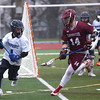 HADLEY GREEN/ Staff photo<br /> Swampscott's Wulf (4) moves the ball while Gloucester's Chris Cassetari (14) plays defense at the Swampscott v. Gloucester boys lacrosse game at the Bertram Athletic Field in Salem on Friday, April 21st, 2017.