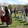 HADLEY GREEN/ Staff photo<br /> Members of the Danvers Alarm List Company stand in Old South Burial Ground at the graves of Ebenezer Goldthwaite, George Southwick, Samuel Cook, and Benjamin Daland, four Danvers men who died on April 19th, 1775 in the Revolutionary War. The Danvers Alarm List Company took part in a series of reenactments to commemorate fallen soldiers on Patriots Day.