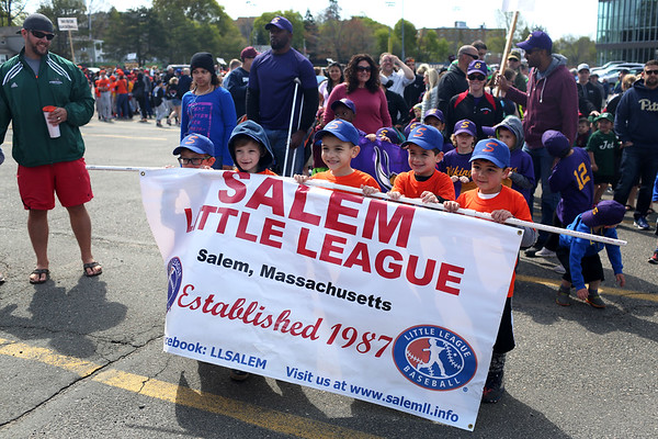 HADLEY GREEN/ Staff photo<br /> Players from Salem Broncos T-ball team, from left to right, Nathan Leonard, Arlo Czahor, Kristian Nunez-Rydgren, Anthony Pasquarello, and Braden Trembley, hold the Salem Little League banner during the annual Little League Parade from Salem State's O'Keefe Center to the Stephen O'Grady Field on Sunday, April 30th, 2017.