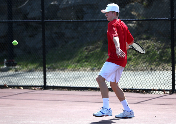 HADLEY GREEN/ Staff photo<br /> Marblehead's Jack Quigley returns the ball while playing singles at the Marblehead v. Gloucester boys tennis match at Marblehead High School on Monday,  April 17th, 2017.