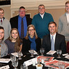 HADLEY GREEN/ Staff photo<br /> Top to bottom, left right: Jeff Bartlet, John Norris, Gary Cowles, Sam Crum, Bret Boudreault, Katie Crum, Pam Crum, Jeff Crum, and Chris Cowles attend the Salem News Student Athlete Award dinner on Thursday, April 6th, 2017.