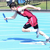 HADLEY GREEN/ Staff photo<br /> Gloucester's Dean Campbell begins the boy's relay at the Danvers v. Gloucester track meet at Danvers High School on Tuesday, April 18th, 2017.