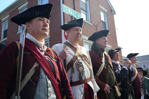 HADLEY GREEN/ Staff photo<br /> From left to right, Henry Rutkowski, William Clemens, and Daniel Cripps, all members of the Danvers Alarm List Company, stand at the annual wreath-laying ceremony honoring the fallen soldiers of south Danvers at the Battle of Lexington at the Lexington Monument in Peabody on Monday, April 17th, 2017.
