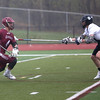 HADLEY GREEN/ Staff photo<br /> Swampscott's Leahy (14) plays defense on Gloucester's Kyle Aquipel (4) at the Swampscott v. Gloucester boys lacrosse game at the Bertram Athletic Field in Salem on Friday, April 21st, 2017.