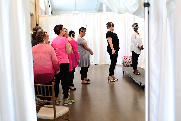 HADLEY GREEN/ Staff photo<br /> The 2017 Miss Pink contestants line up backstage during the rehearsal for the annual Miss Pink Pageant held at the Danversport Yacht Club on April 8th, 2017.