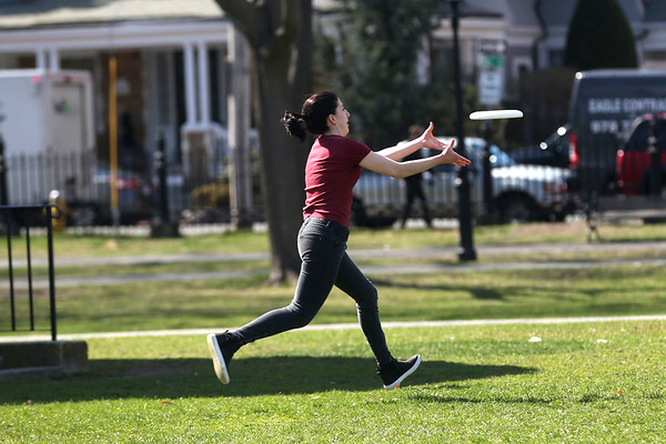 HADLEY GREEN/ Staff photo<br /> Viviana Aluia of Somerville plays frisbee with friends at the Salem Common on April 13th, 2017.