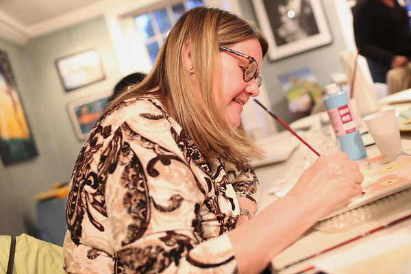 HADLEY GREEN/ Staff photo<br /> Claudia Kaufman of Marblehead paints a dish at Paint and Sip Pottery Night with Patti DiCarlo Baker & Hestia Studios on April 14th, 2017.