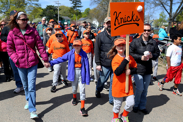 HADLEY GREEN/ Staff photo<br /> Players from the Knicks team march in the Salem Little League parade from Salem State's O'Keefe Center to the Stephen O'Grady Field on Sunday, April 30th, 2017.