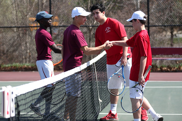 HADLEY GREEN/ Staff photo<br /> Gloucester's Joe Kibango and Anthony Parco (left) shake hands with Marblehead's Reid Tully and Anthony Gluskin (right) after their game at the Marblehead v. Gloucester boys tennis match at Marblehead High School on Monday,  April 17th, 2017.