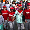HADLEY GREEN/ Staff photo<br /> From left to right, Alyvia Feliz, Aliza Ovievo, Elsa Whitehead, Lizzy Mahady, and Liana Feliz, all players on the Clippers minor league team, wave while marching in Salem's Little League parade on Sunday, April 30th, 2017.