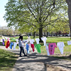 HADLEY GREEN/ Staff photo<br /> Salem State students organized an installation of the Clothesline Project on the Salem Common for the annual Walk for HAWC. Messages are written on clothing items to raise awareness and commemorate people who have been victims of domestic violence.