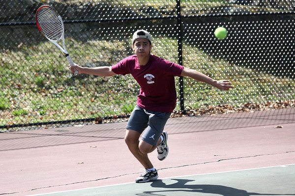 HADLEY GREEN/ Staff photo<br /> Gloucester's Roger Tanaka prepares to hit the ball while playing singles at the Marblehead v. Gloucester boys tennis match at Marblehead High School on Monday,  April 17th, 2017.