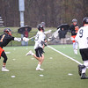 HADLEY GREEN/ Staff photo<br /> Marblehead goalie Matt Millis runs out of the goal to pass the ball while Beverly's Nick DiLusio (1) at the Marblehead v. Beverly boys varsity lacrosse game held at Marblehead High School on Tuesday, April 25th, 2017.